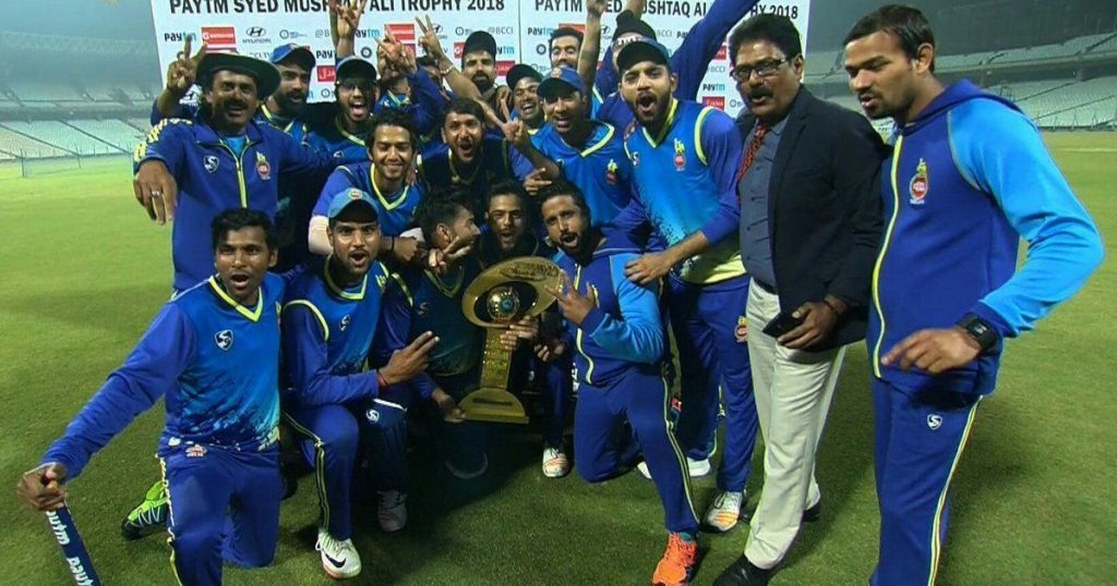 Delhi team with trophy