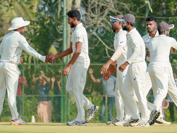 kerala team celebrates on fall of wicket of opposition