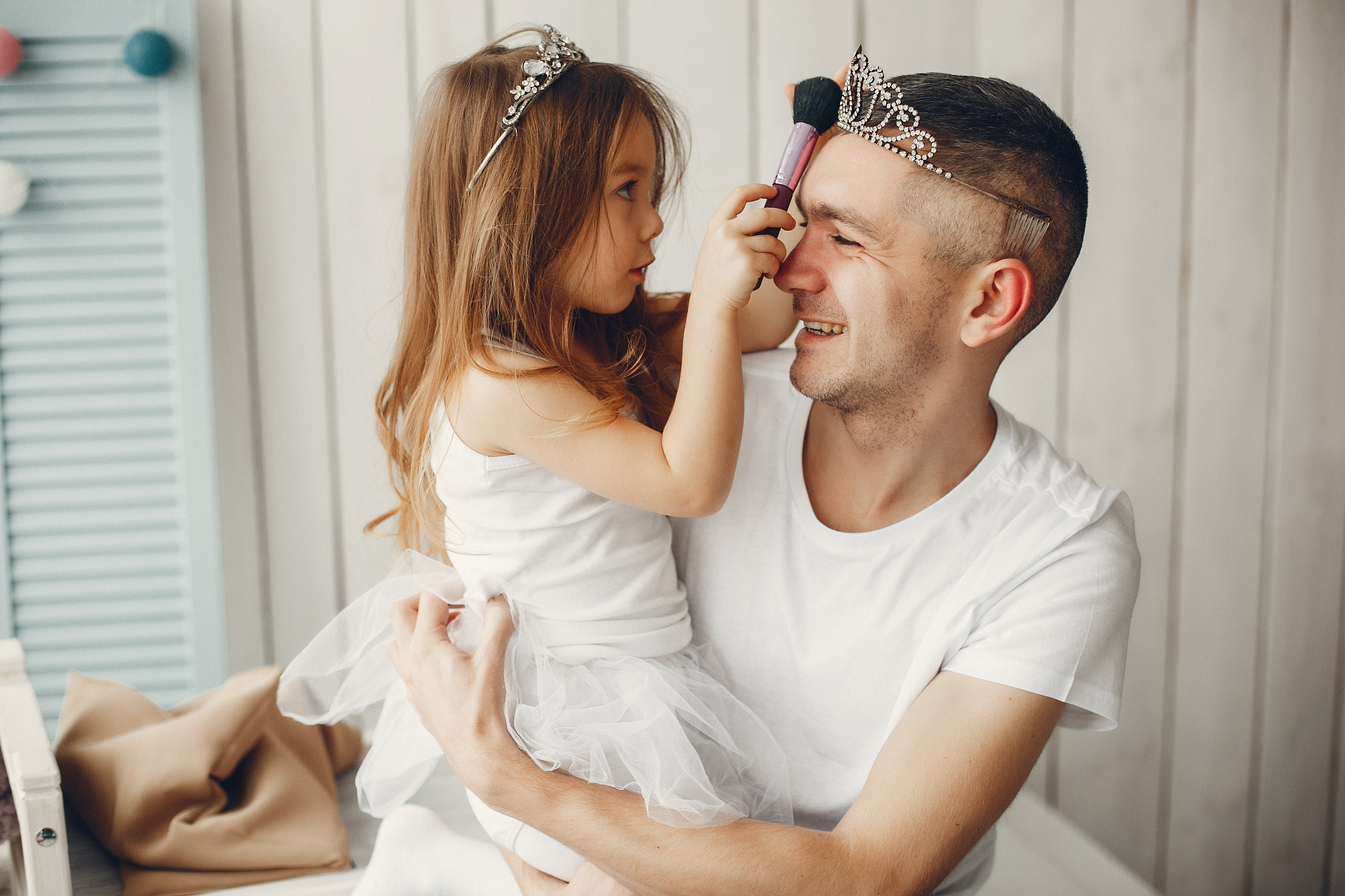 Family at home. Little girl playing with a father.